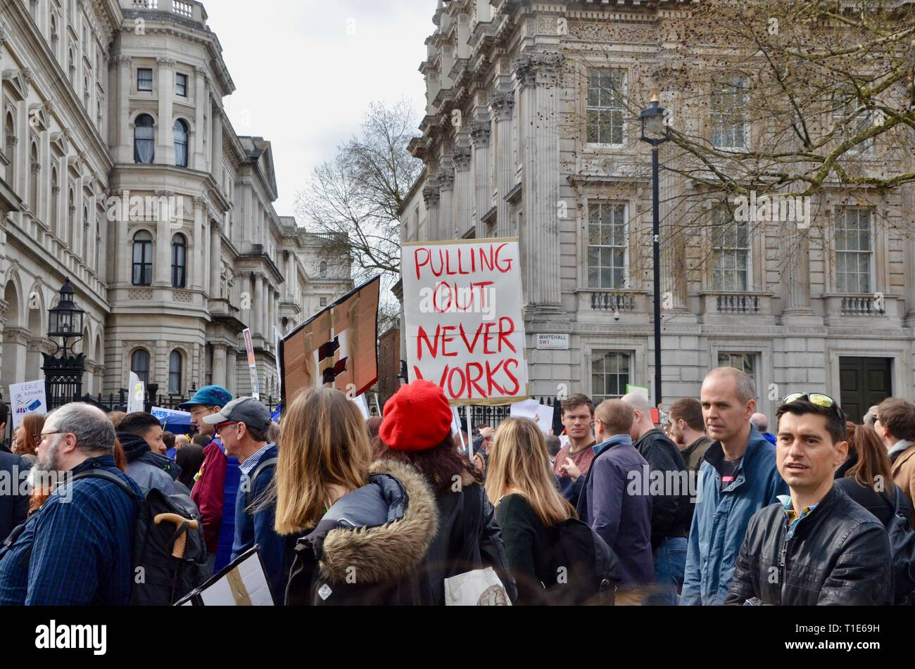 scenes from the anti brexit pro peoples vote march in london 23rd march 2019 pulling out never works placard - Stock Image