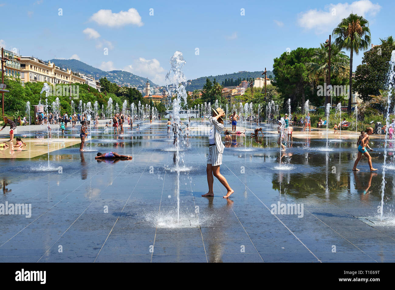 Nice (south-eastern France): someone walking on the reflecting pool