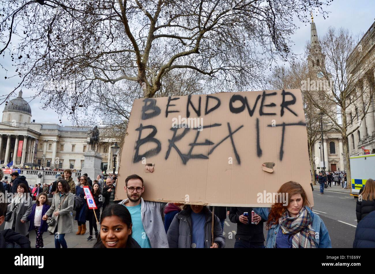scenes from the anti brexit pro peoples vote march in london 23rd march 2019 bend over brexit placard - Stock Image