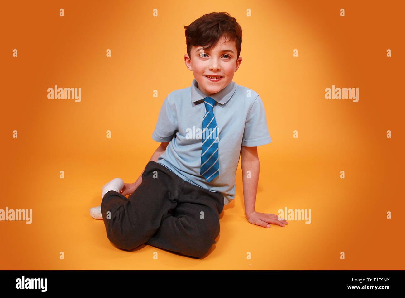 happy young boy in school uniform Stock Photo