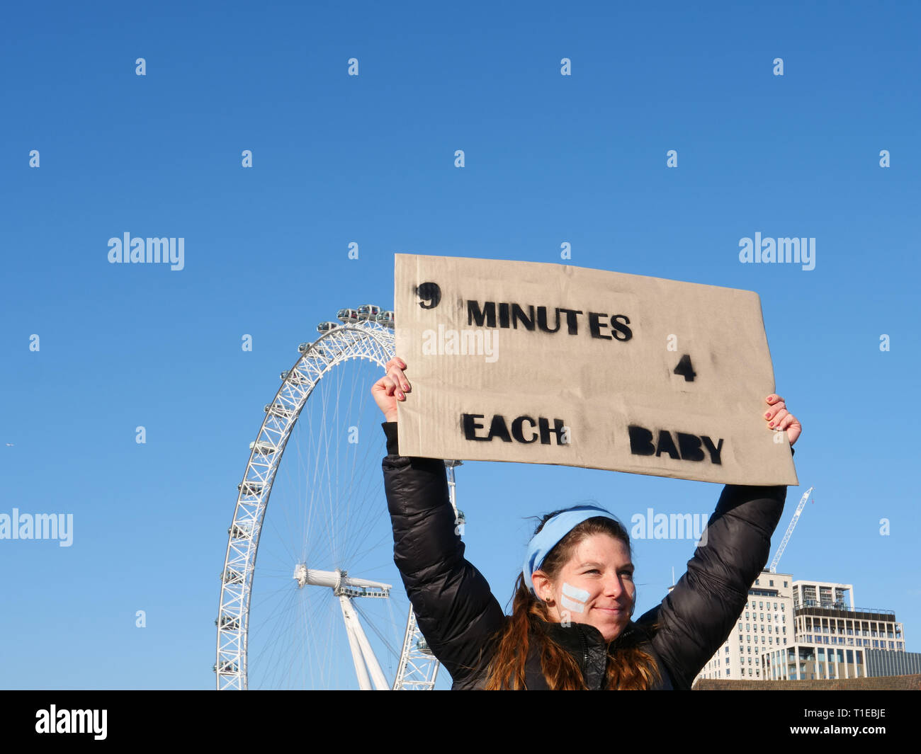London, UK. 25th March, 2019. A group of young people, on a March for Life, demonstrate on Parliament Square, London, UK and walk to Westminster Bridge for a 9 minutes protest to highlight that since David Steel's Abortion Act 1967, 9 million abortions have been performed in the UK. Credit: Joe Kuis / Alamy Live News Stock Photo