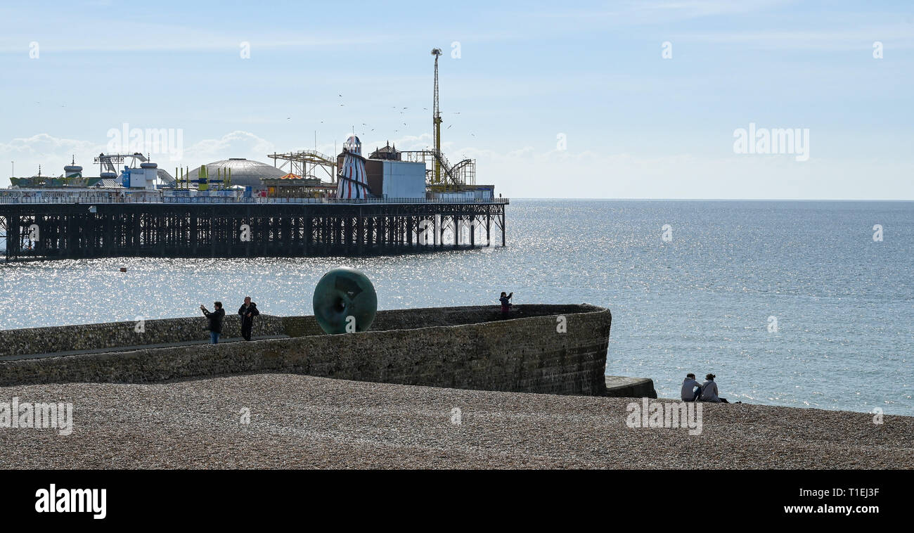 Brighton, UK. 26th Mar, 2019. Visitors enjoy a beautiful sunny Spring day on Brighton Beach as the weather is forecast to be warm with sunshine throughout Britain over the next few days Credit: Simon Dack/Alamy Live News Stock Photo