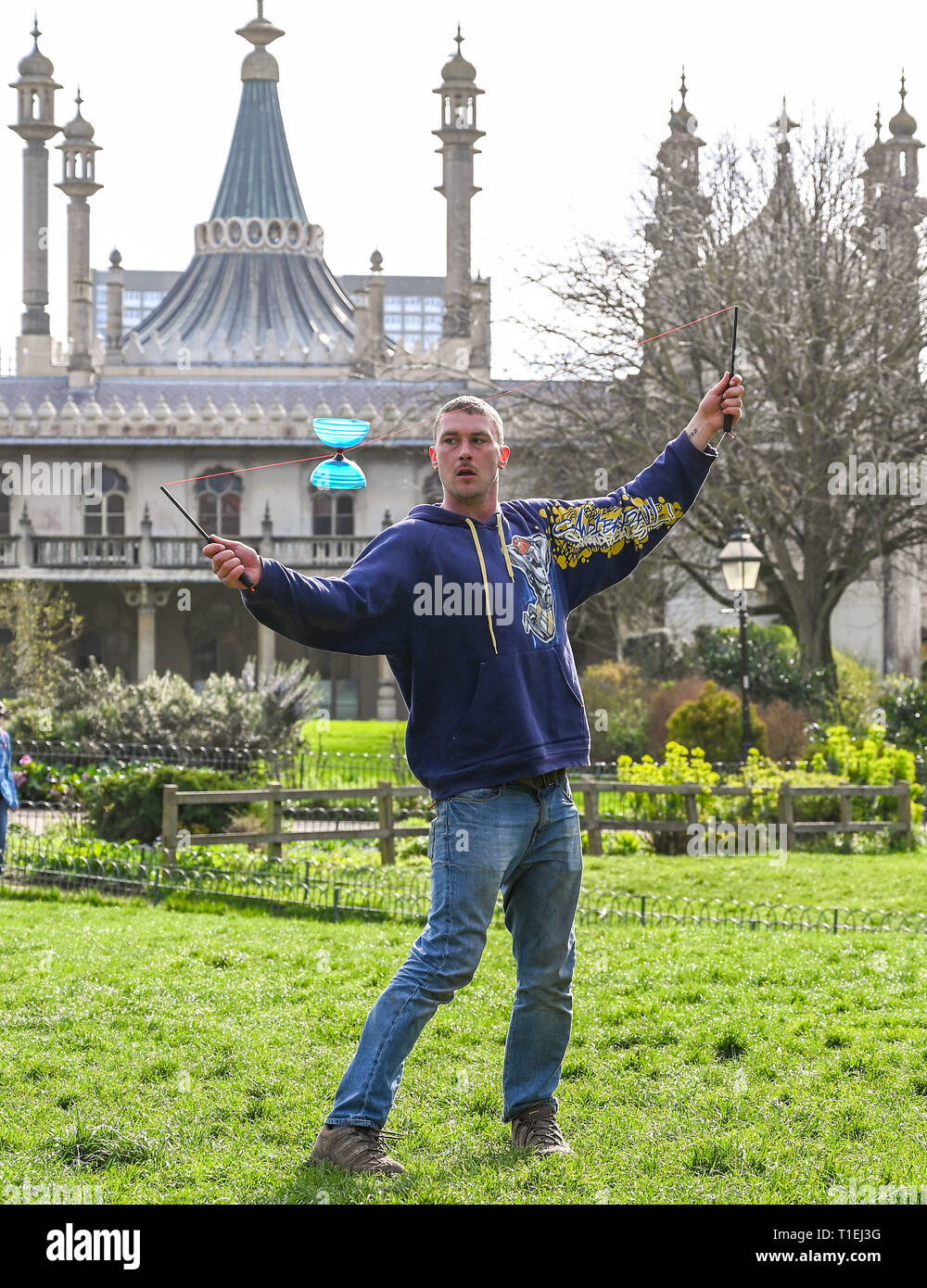 Brighton, UK. 26th Mar, 2019. Shane McQuire hones his diablo skills by Brightons Royal Pavilion on a lovely sunny Spring day as the weather is forecast to be warm with more sunshine throughout Britain over the next few days Credit: Simon Dack/Alamy Live News Stock Photo