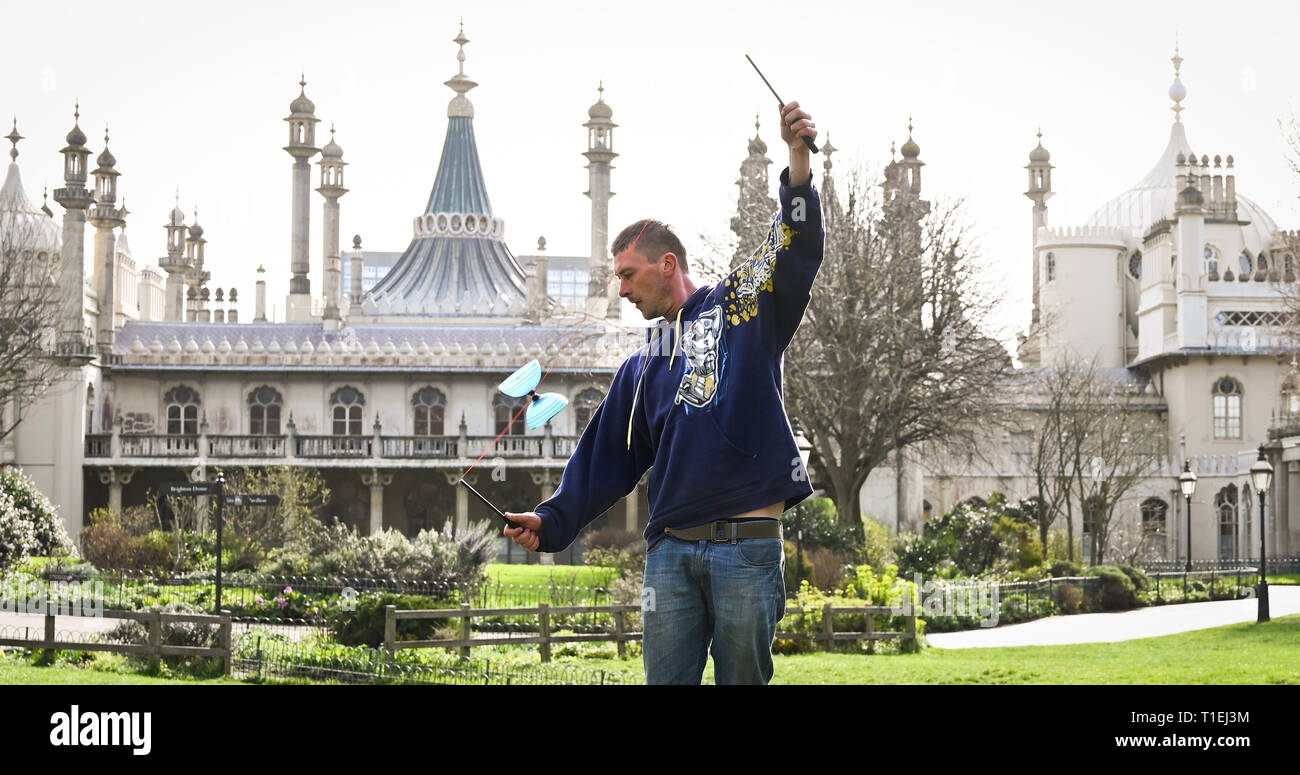 Brighton, UK. 26th Mar, 2019. Shane McQuire hones his diablo skills by Brightons Royal Pavilion on a lovely sunny Spring day as the weather is forecast to be warm with more sunshine throughout Britain over the next few days Credit: Simon Dack/Alamy Live News - Stock Image