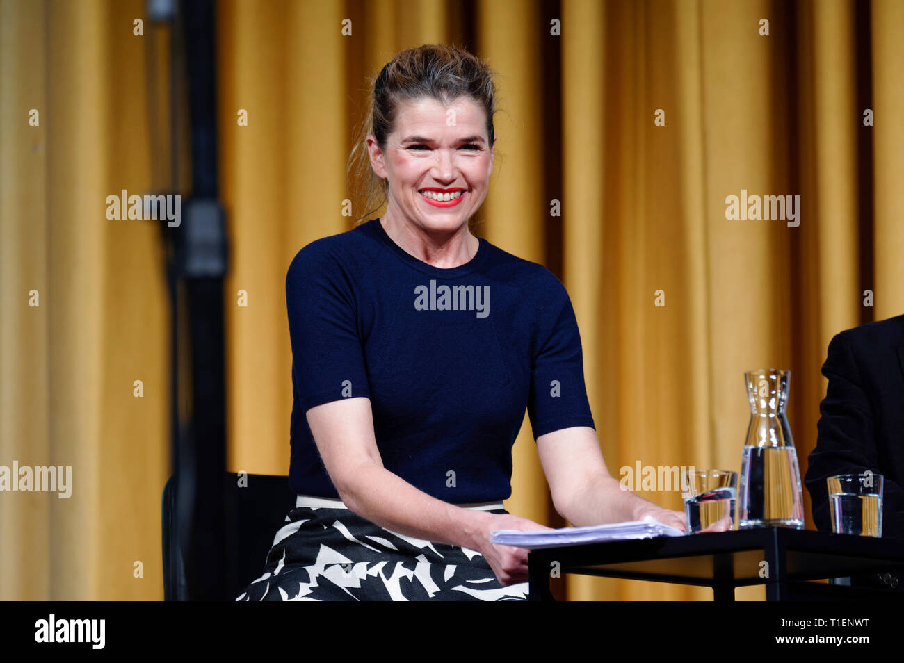 26 March 2019, North Rhine-Westphalia, Köln: The actress Anke Engelke sits on the podium at the event '. the moose bull can't roar quite as loudly as usual .' at the Literature Festival Lit. Cologne. Photo: Henning Kaiser/dpa - Stock Image
