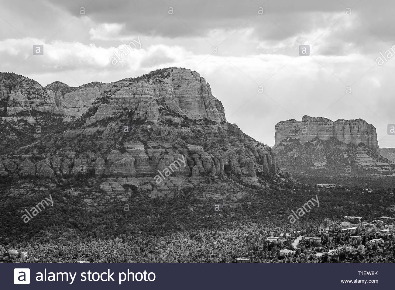 Landscape of the red rocks of Sedona, Arizona in black and white. These mountains are towering over the small town. - Stock Image
