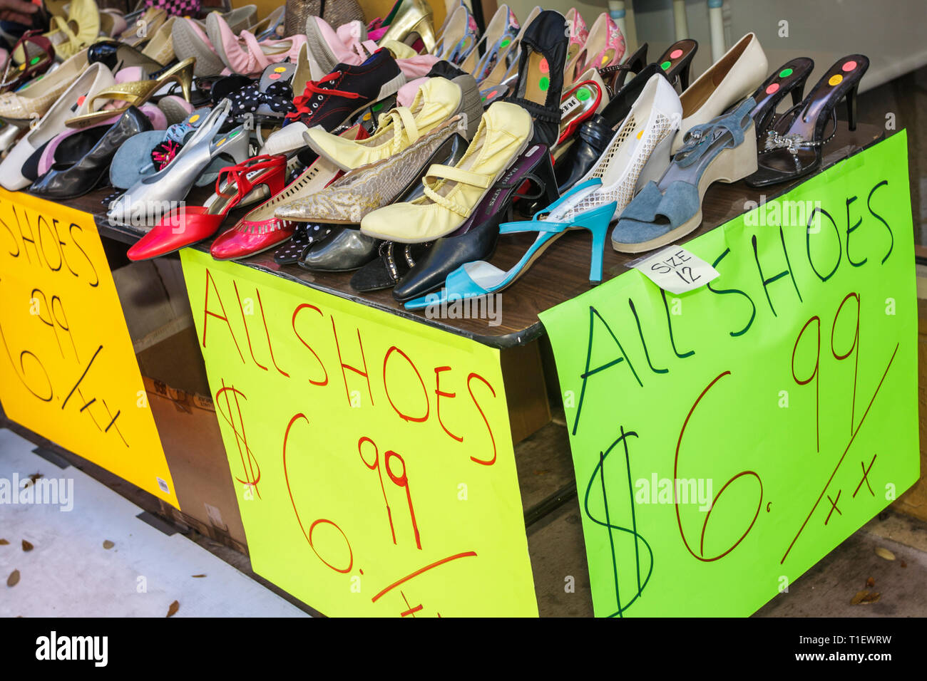 Miami Coral Gables Miami Florida Coral Way Miracle Mile store shop small business sidewalk sale sign price shoes bargain Stock Photo