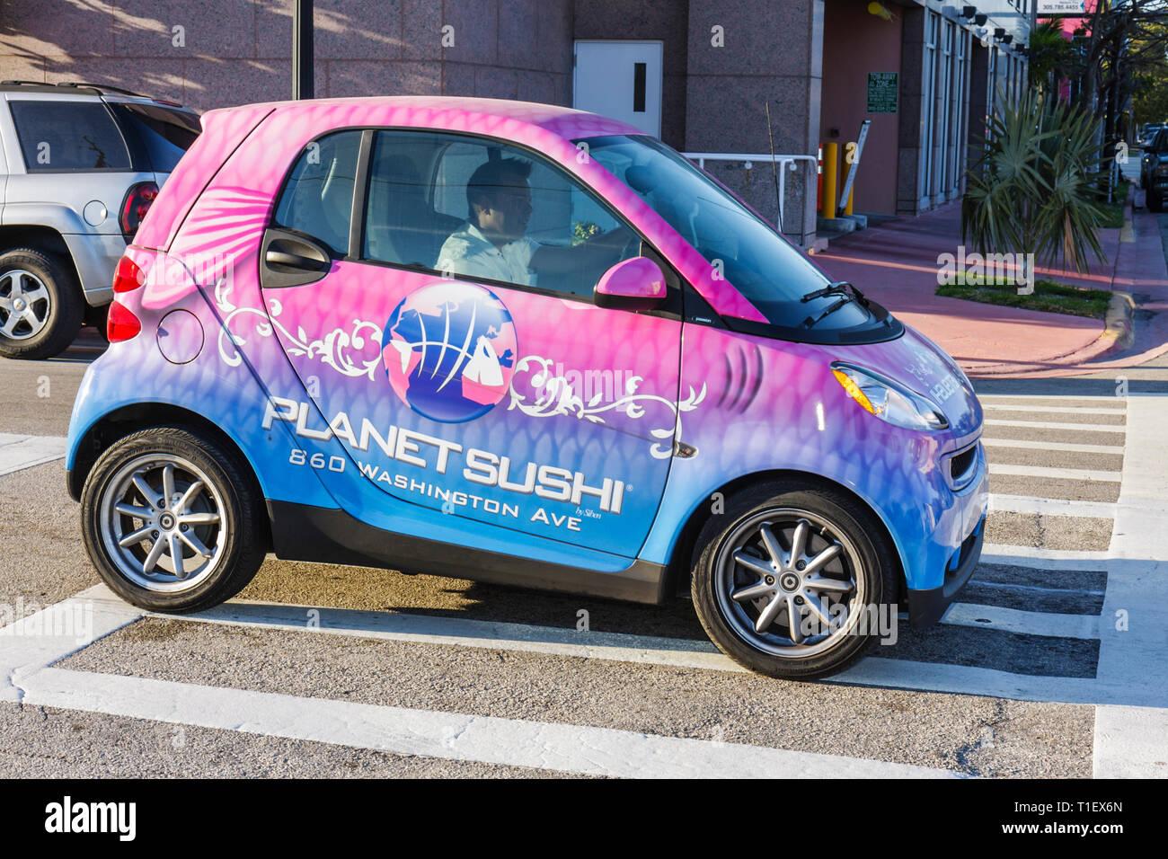 Miami Beach Florida Planet Sushi restaurant smart fortwo coupe car auto alternative transportation fuel efficient recyclable mat - Stock Image