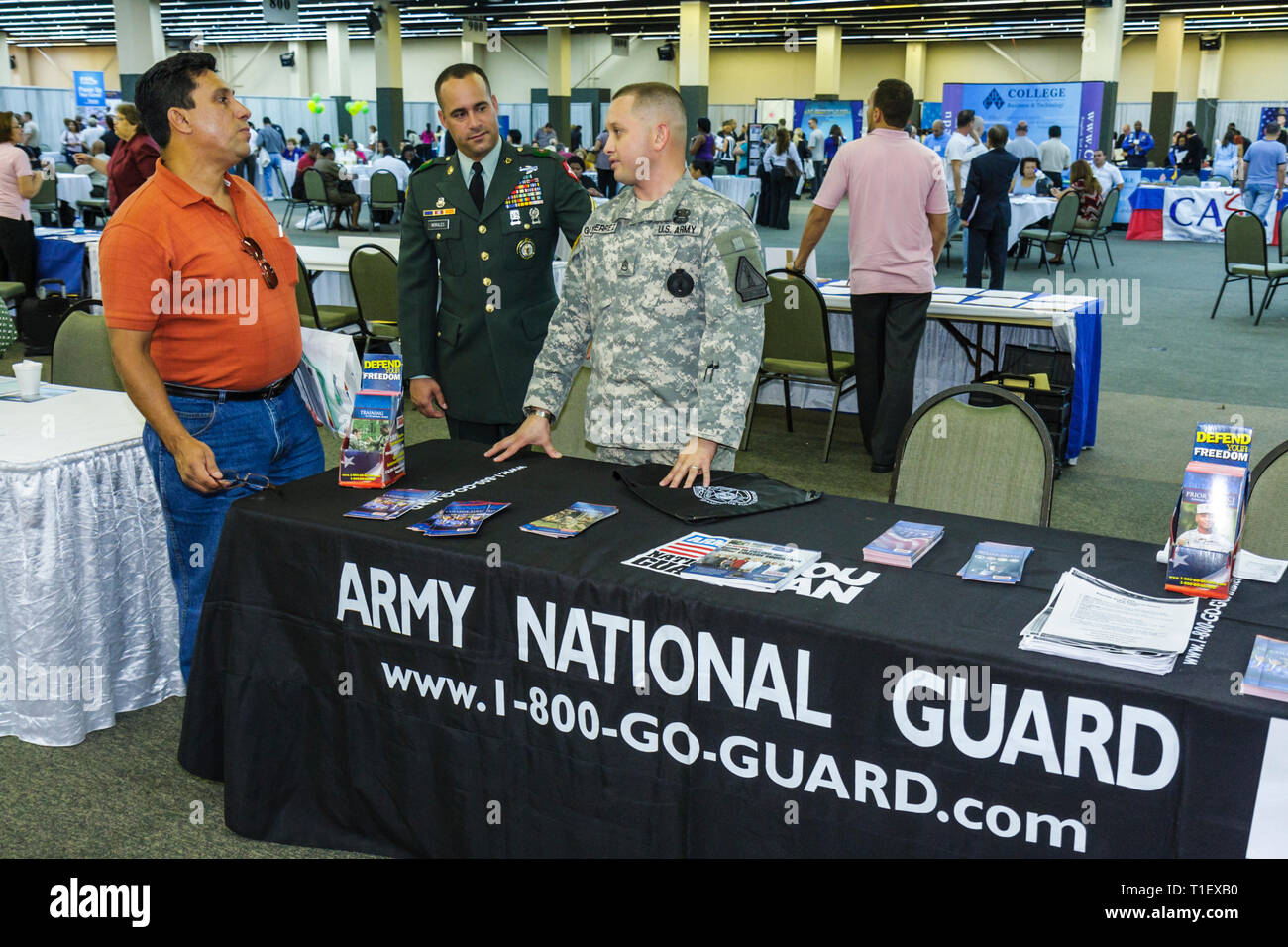 Miami Florida Job Fair career employment jobless labor job seeker employer recruiting economic crisis booth Army National Guard - Stock Image