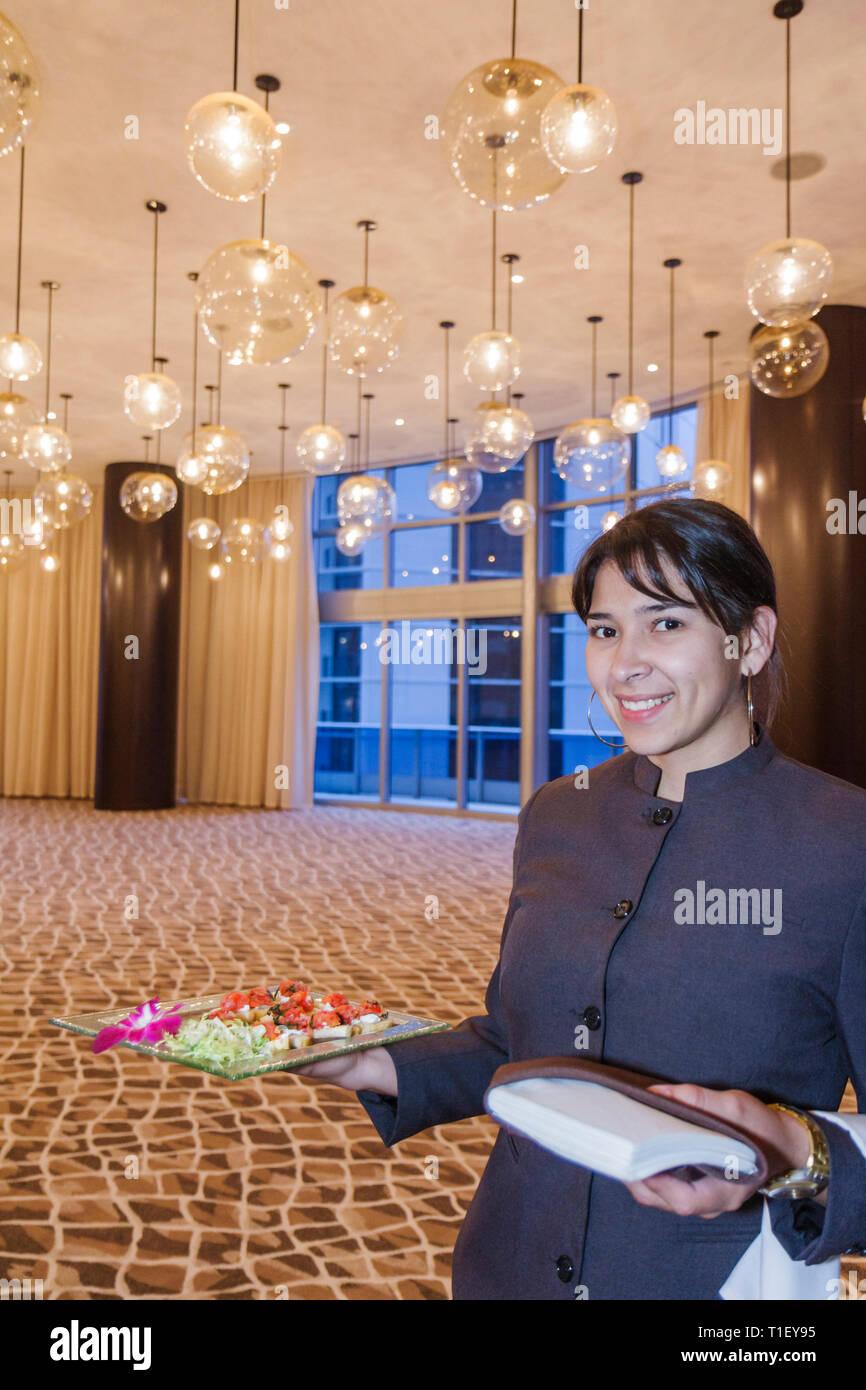 Miami Florida Epic Hotel luxury boutique hostess job Hispanic woman
