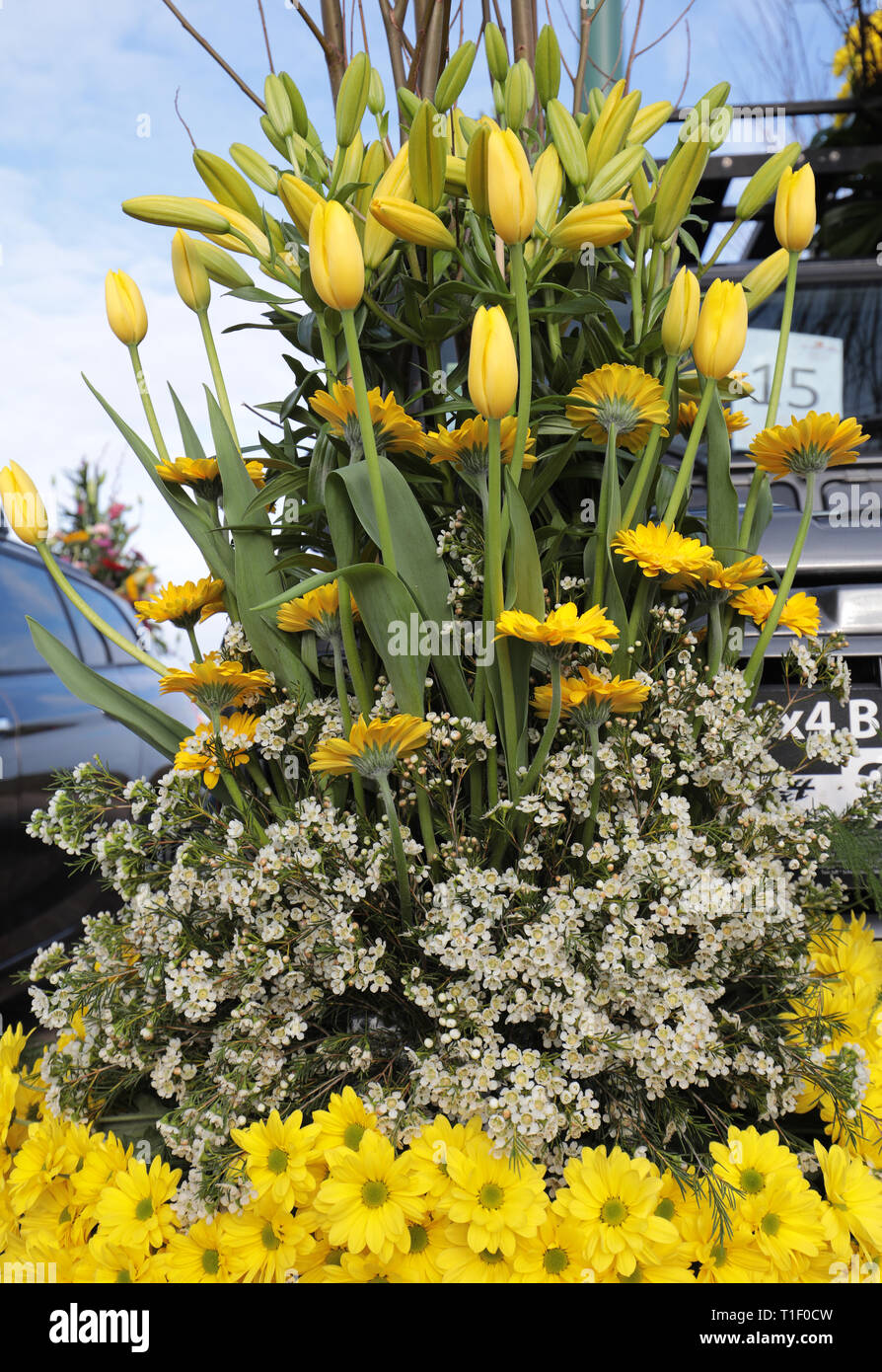 Floristic decoration with yellow lilies and gerberas Stock Photo