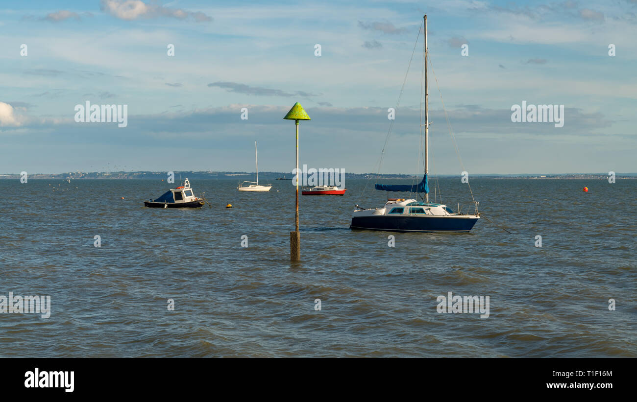 Boats on the shore of the River Thames, seen in Southend-on-Sea, Essex, England, UK Stock Photo