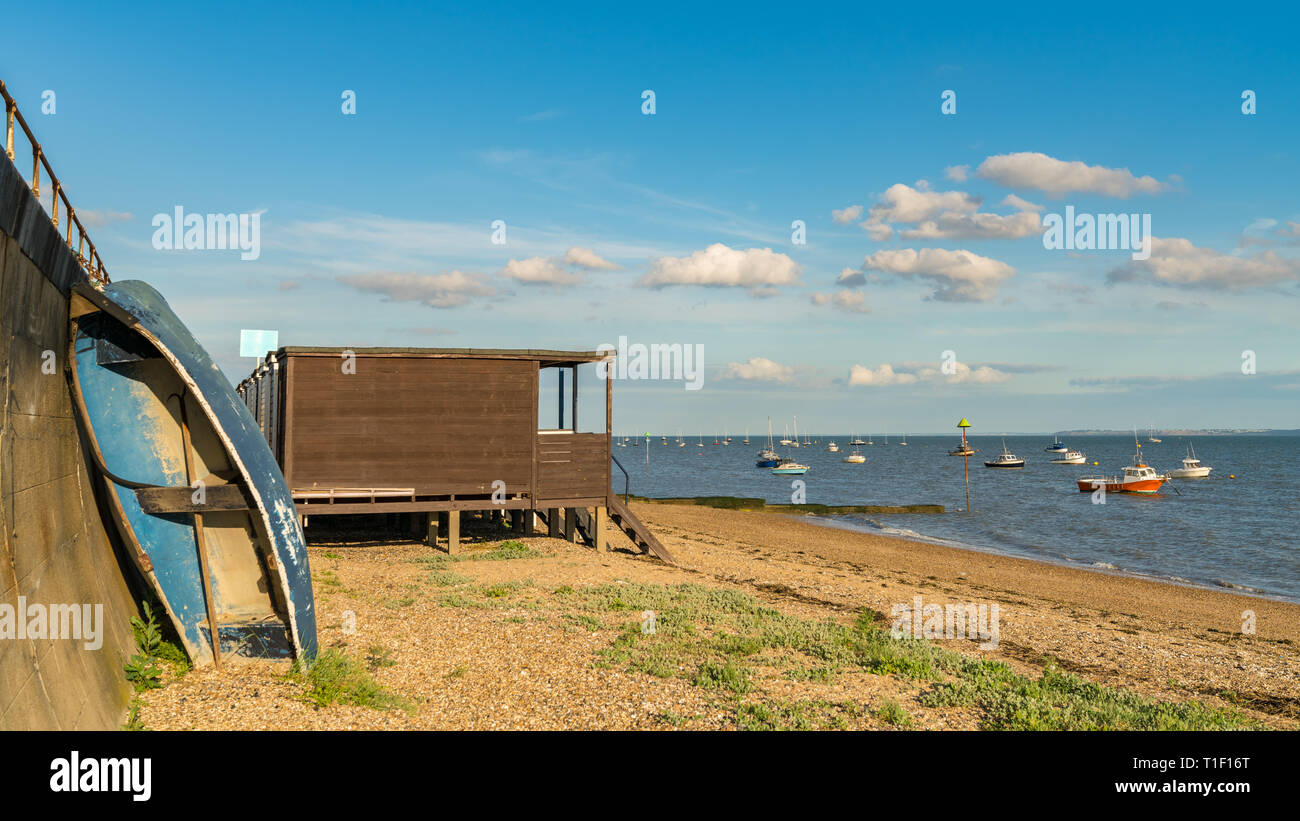Beach huts on the shore of the River Thames, seen in Southend-on-Sea, Essex, England, UK Stock Photo