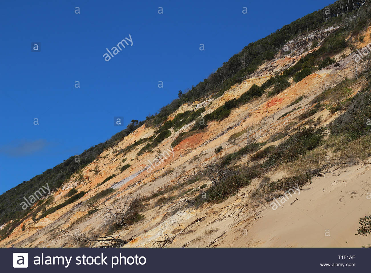 Coloured sand cliffs at Rainbow Beach in Queensland, Australia - Stock Image