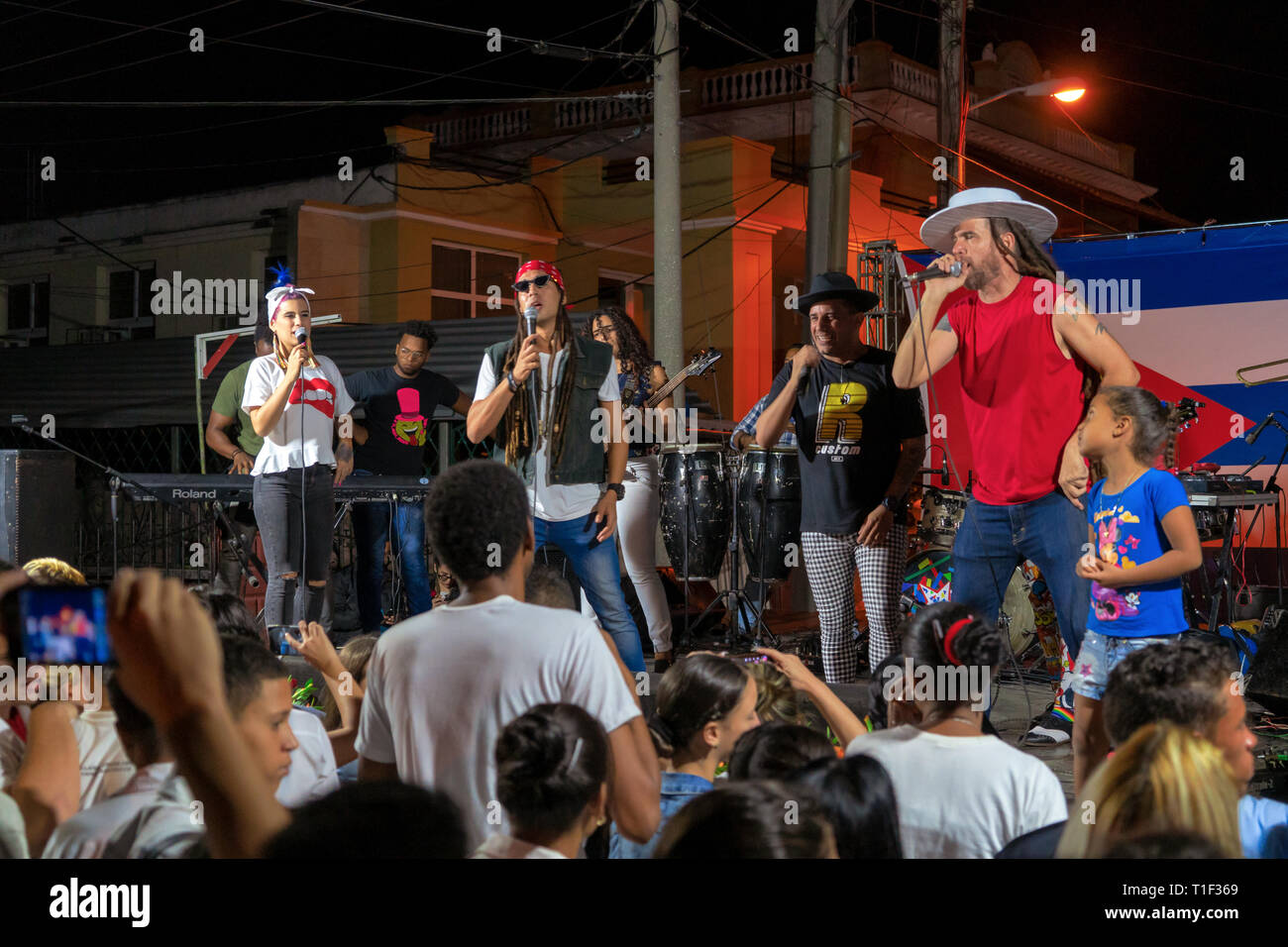 Santa Clara, Cuba - January 27 2019: Night performance of the qva libre musical group seen from the public. Young people watching the performance of t - Stock Image