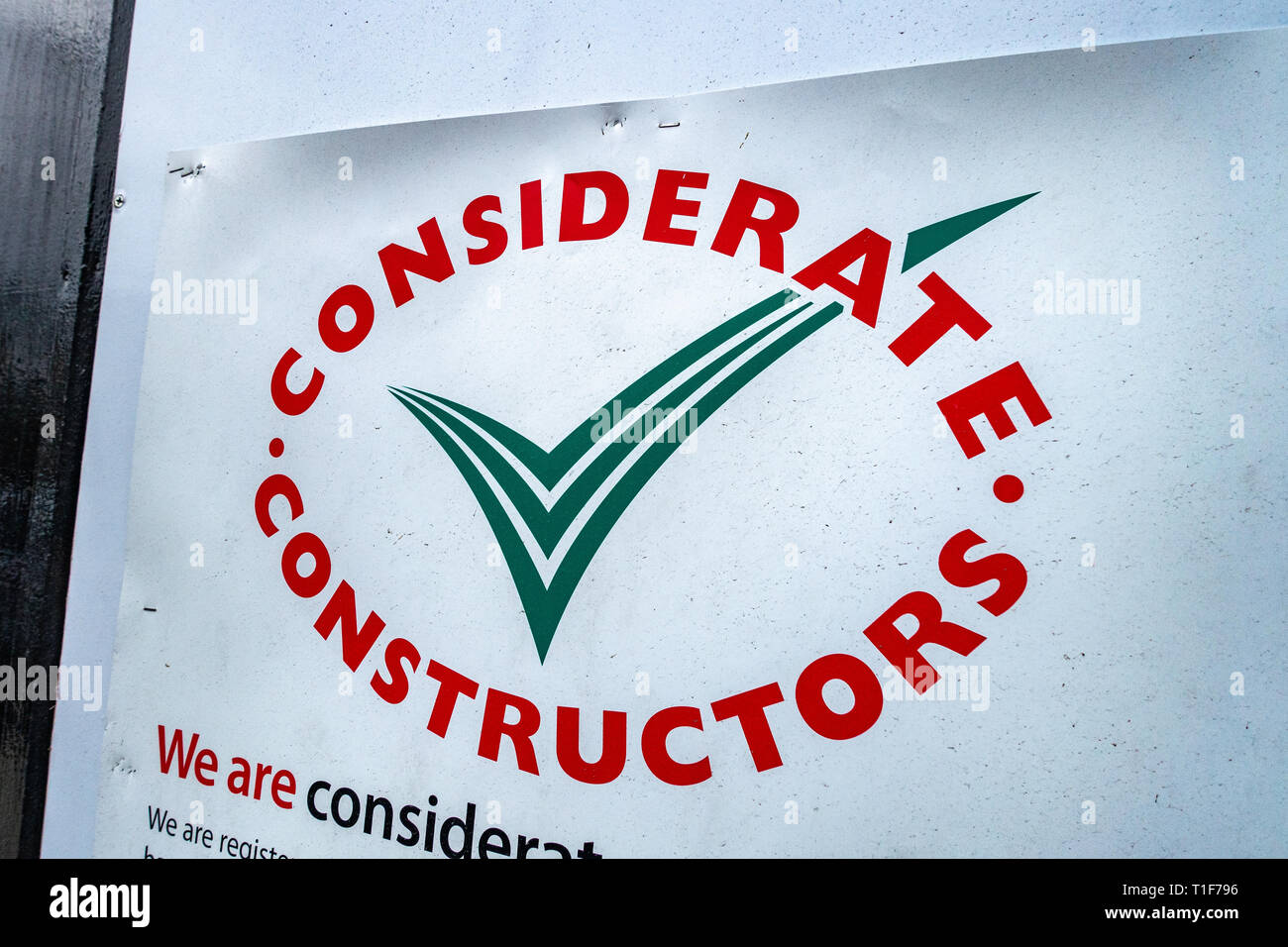 Considerate constructors sign on construction site development security wall - Stock Image