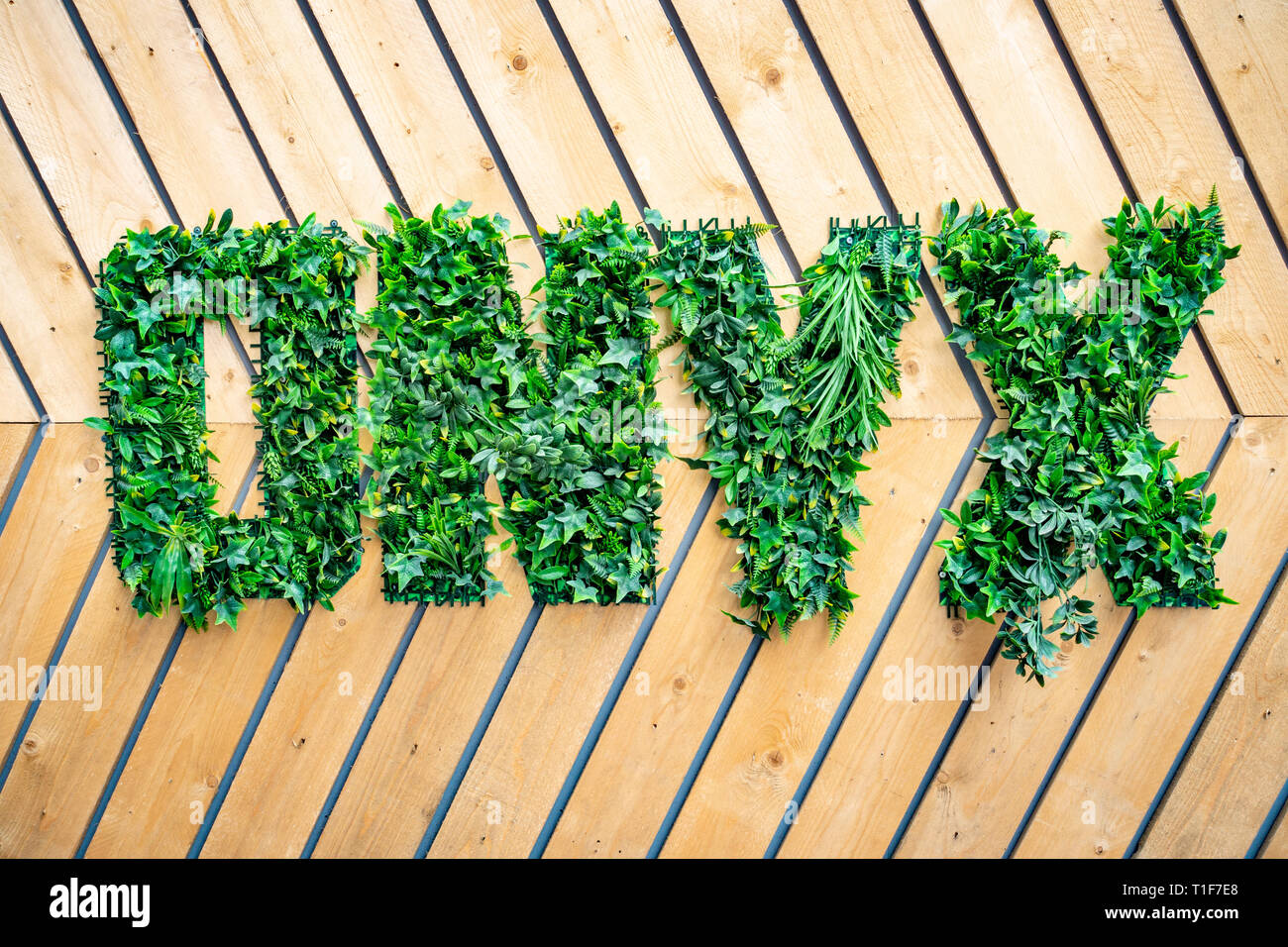 Onyx name logo planted in three-dimensional sign made with greenery plants at a building development Stock Photo
