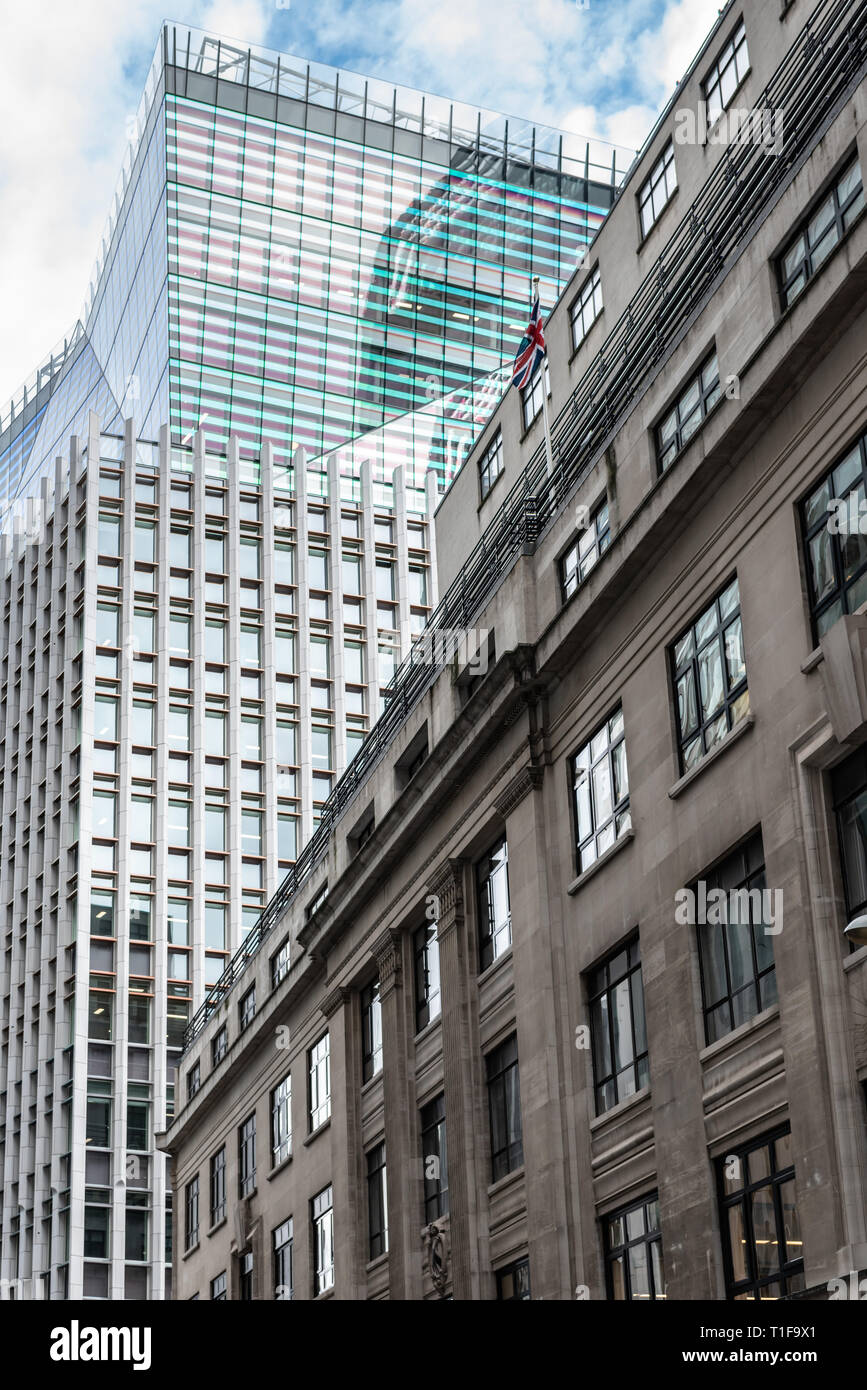Contrasting building styles in Fenchurch Avenue in the City of London - Stock Image
