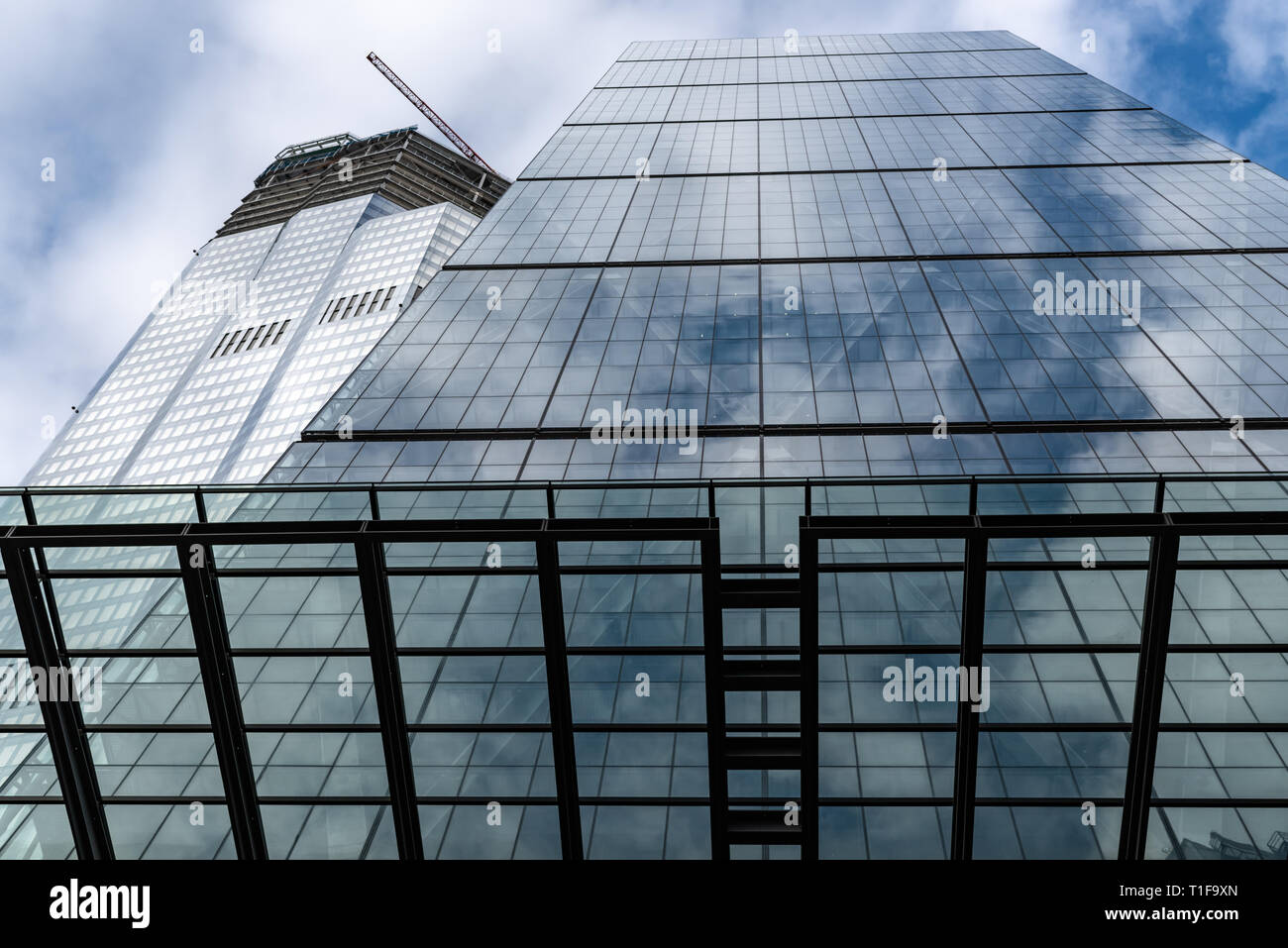 The sloping south face of the 'Cheesegrater' (Leadenhall Building)  and new 100 Bishopsgate building. - Stock Image