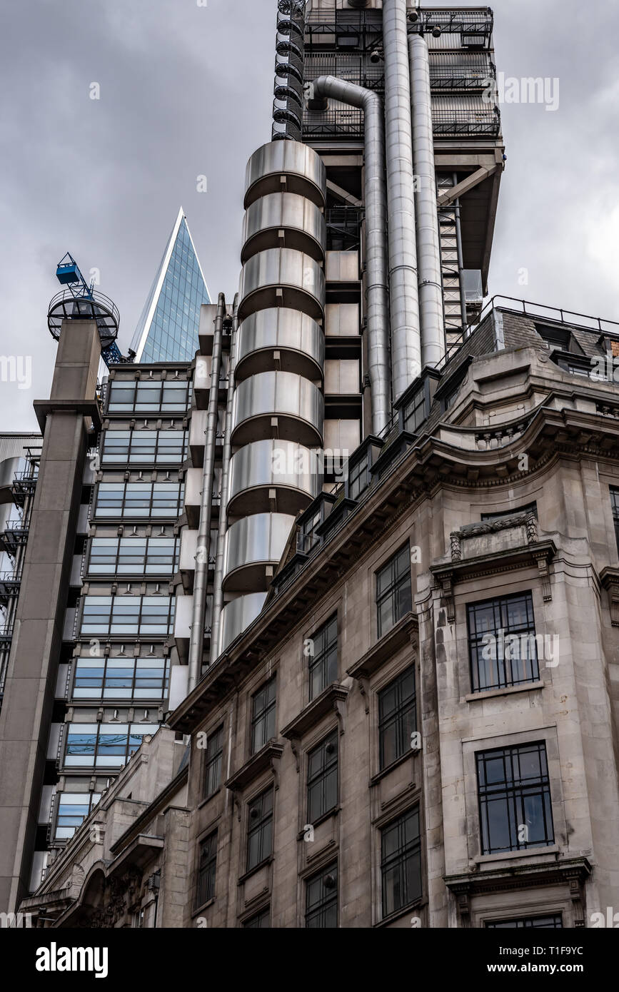 The steel Lloyds Building and glass 'Scalpel' (W R  Berkley Tower) rise high above the more classical buildings of Lime Street in the City of London - Stock Image
