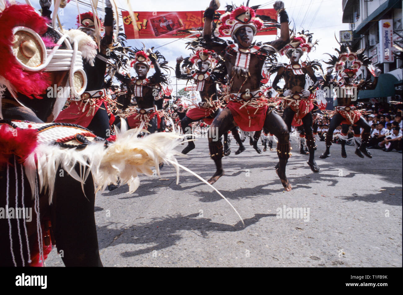 Kalibo, Philippines - 12 Januray 1999: People on costumes at the parade of Ati-Atihan festival in Kalibo, Philippines - Stock Image