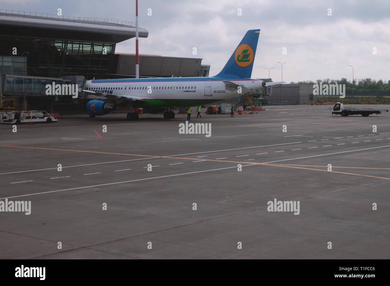 Kazan, Russia - Jul 19, 2018: Passenger plane at teleladder at airport - Stock Image