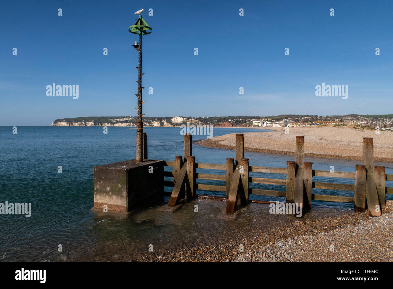 View across to Seaton over the river Axe as it reaches the sea between Axmouth and Seaton. Stock Photo