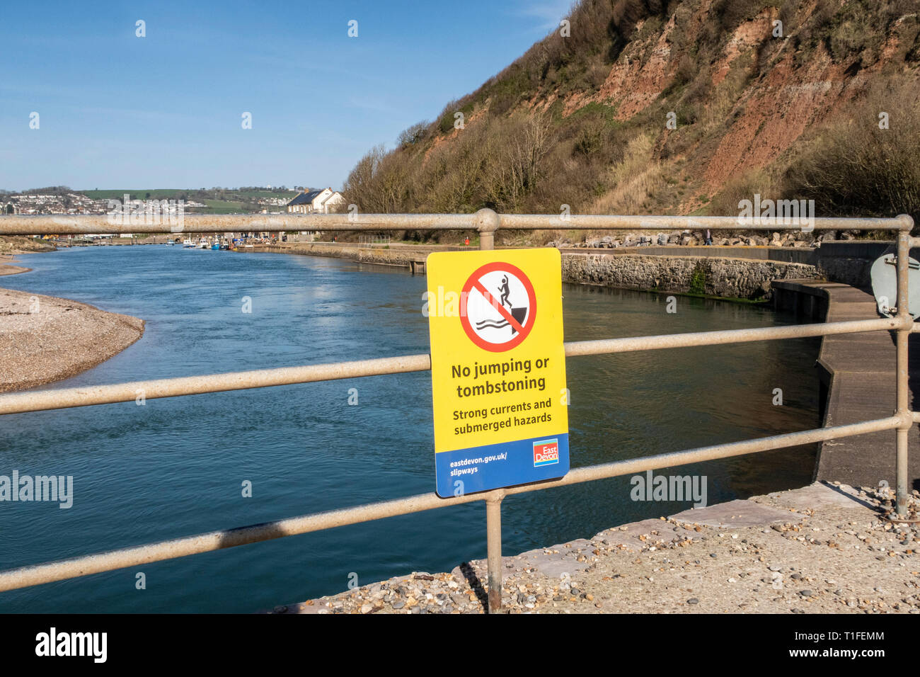 No jumping or tombstoning sign.The river Axe as it reaches the sea between Axmouth and Seaton. Stock Photo