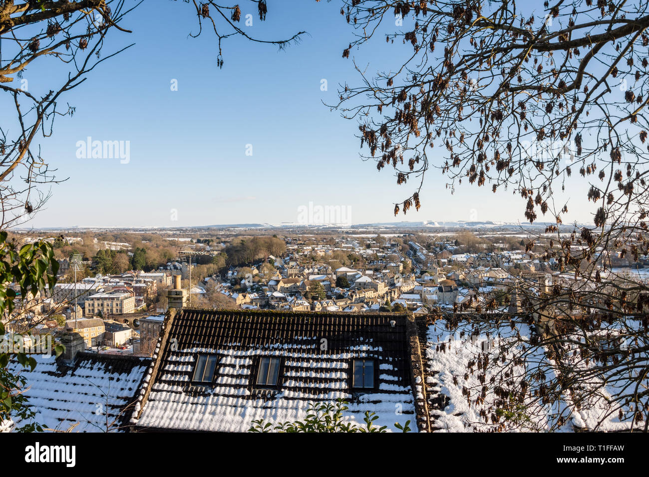 A view from a footpath above Tory across a sunny snowy Bradford on Avon and Wiltshire countryside Stock Photo