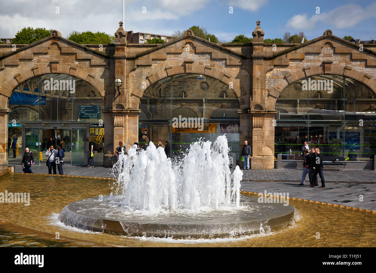 SHEFFIELD, ENGLAND - MAY 8, 2009: The view of the fountain on the Sheaf Square in front of Sheffield railway station building. South Yorkshire. Englan - Stock Image