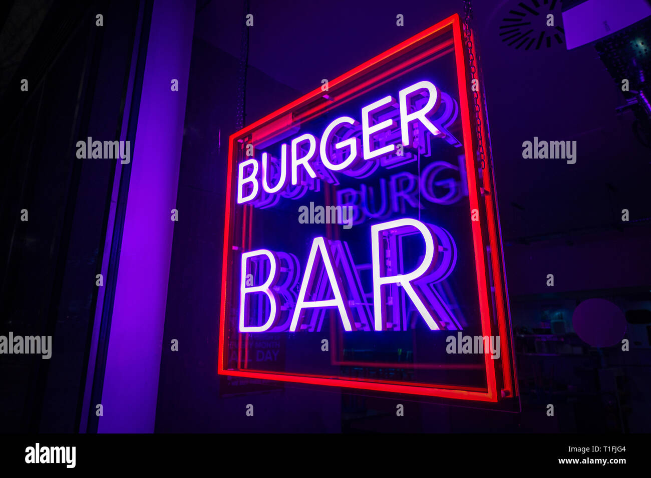 Burger Bar square Neon Sign lit up in a restaurant near Granary