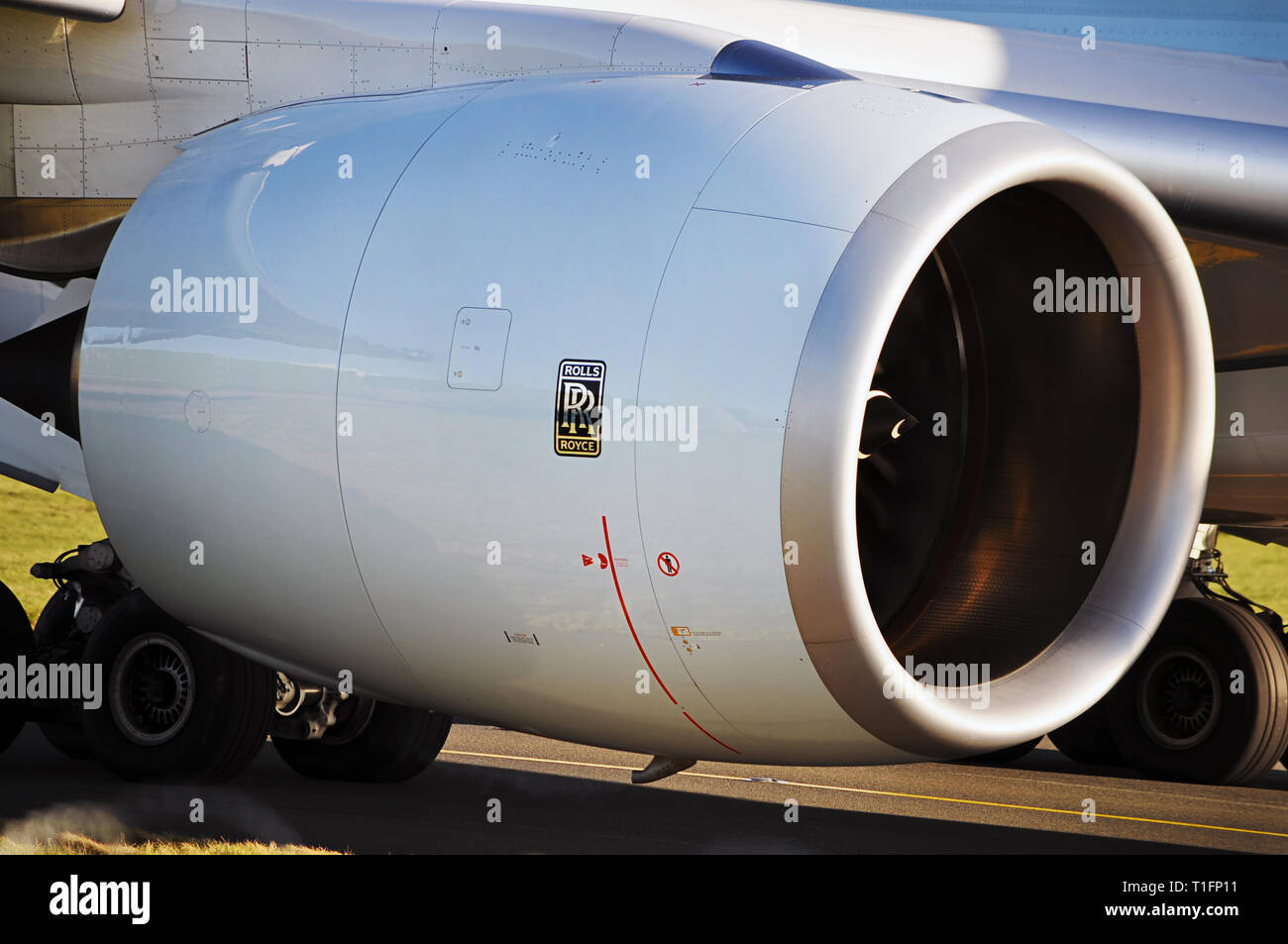 Manchester Airport, United Kingdom - January 8, 2018: Rolls Royce Trent XWB turbofan jet engine taxiing the aircraft to the runway. - Stock Image