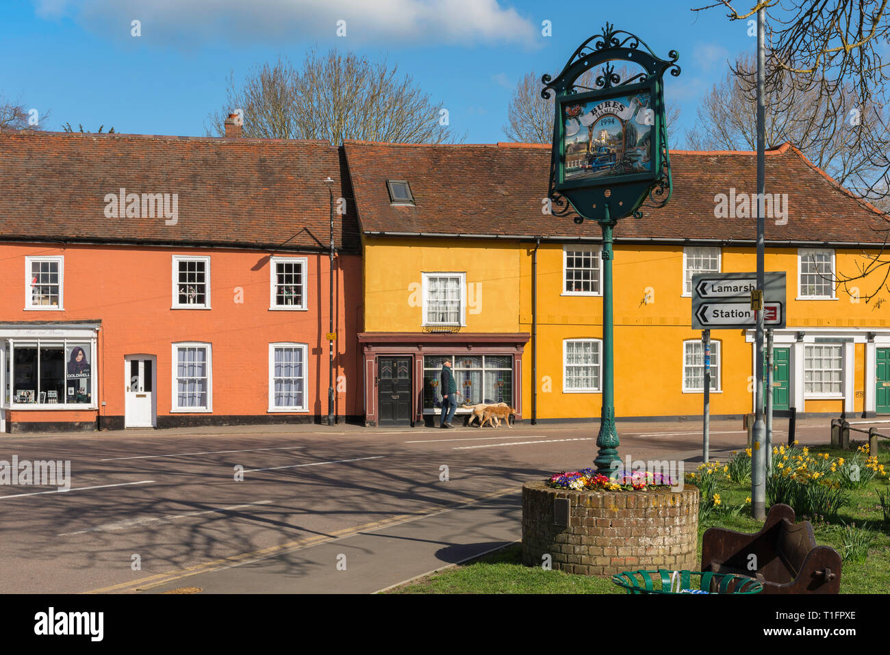 Bures UK, view of colourful houses in Bridge Street in Bures Hamlet on the Essex side of the village of Bures (Suffolk) England, UK. - Stock Image