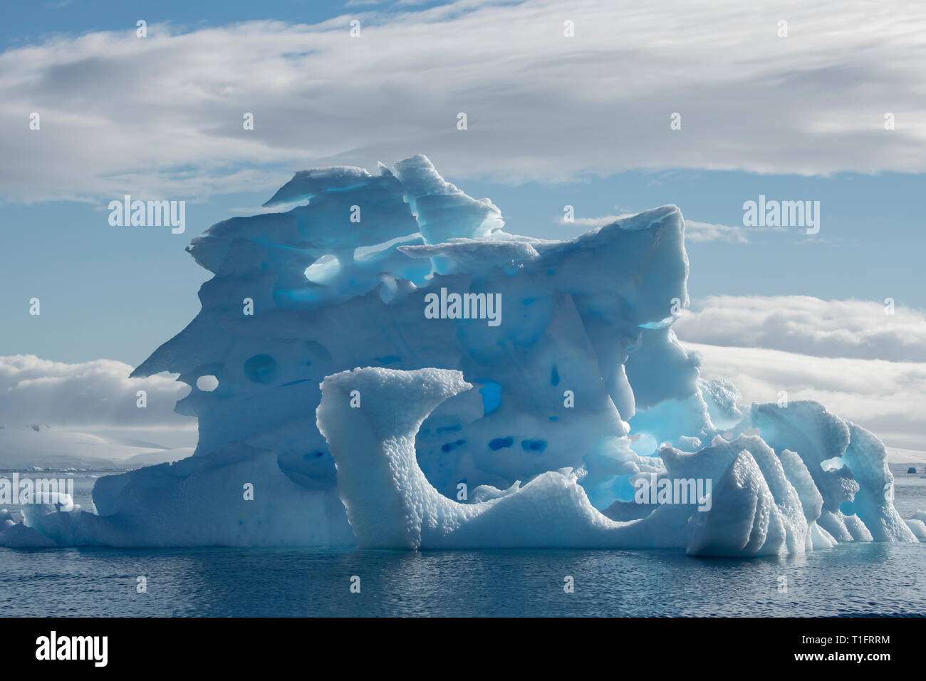 Antarctica. Cuverville Island located within the Errera Channel between Ronge Island and the Arctowski Peninsula. Large blue iceberg. Stock Photo