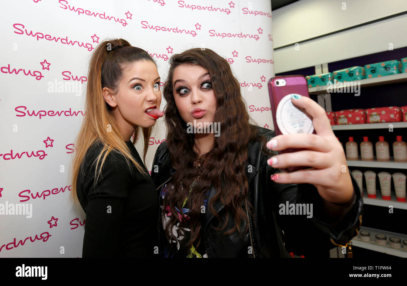 Vlogger and internet personality Zoe Suggs aka Zoella pulls a silly face as she poses for a selfie with a fans at Superdrug's store in Churchill Square in Brighton 30 October 2014 - Stock Image