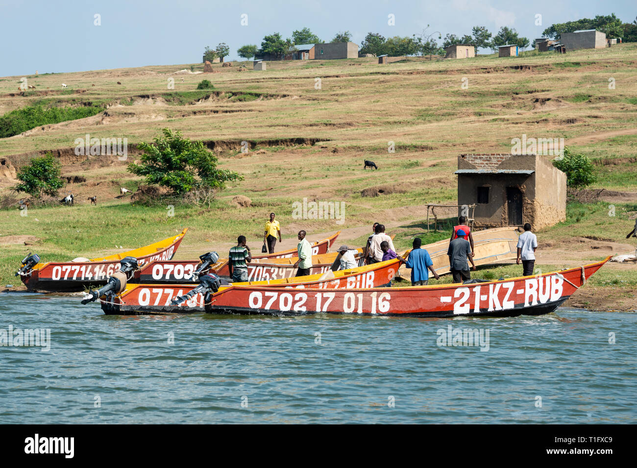 Local fisherman with their boats beside Kazinga Channel within Queen Elizabeth National Park, South West Uganda, East Africa Stock Photo