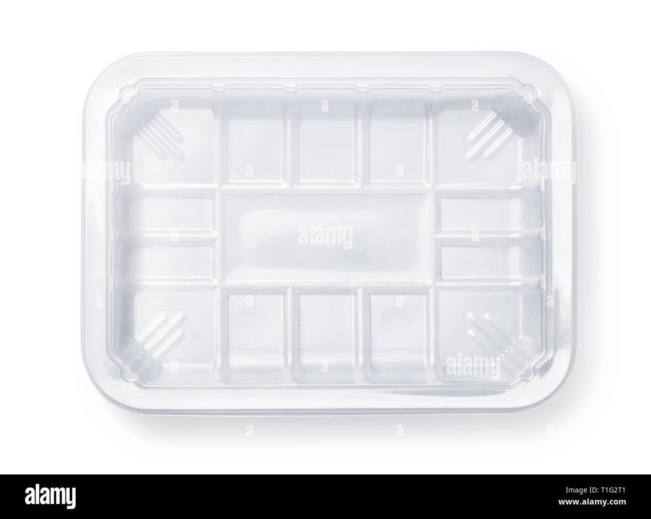 Top view of transparent plastic food packing tray isolated on white - Stock Image