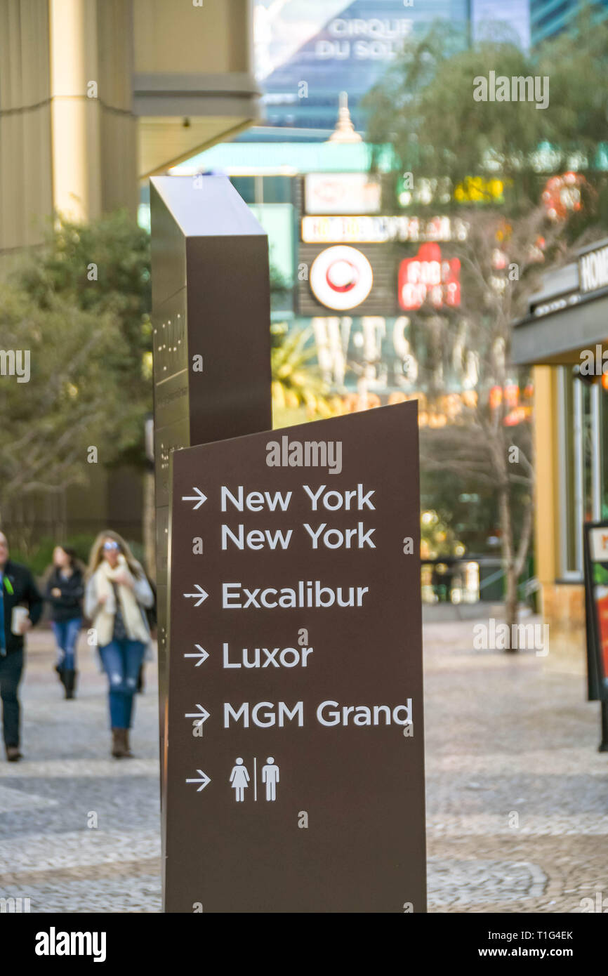 LAS VEGAS, NV, USA - FEBRUARY 2019: Sign on a side walk on the Las Vegas Strip showing the direction to various hotels and public restrooms, - Stock Image