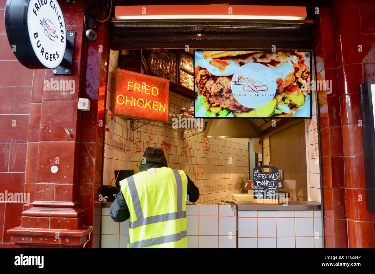 fried chicken burger take away at leicester square underground station london england - Stock Image