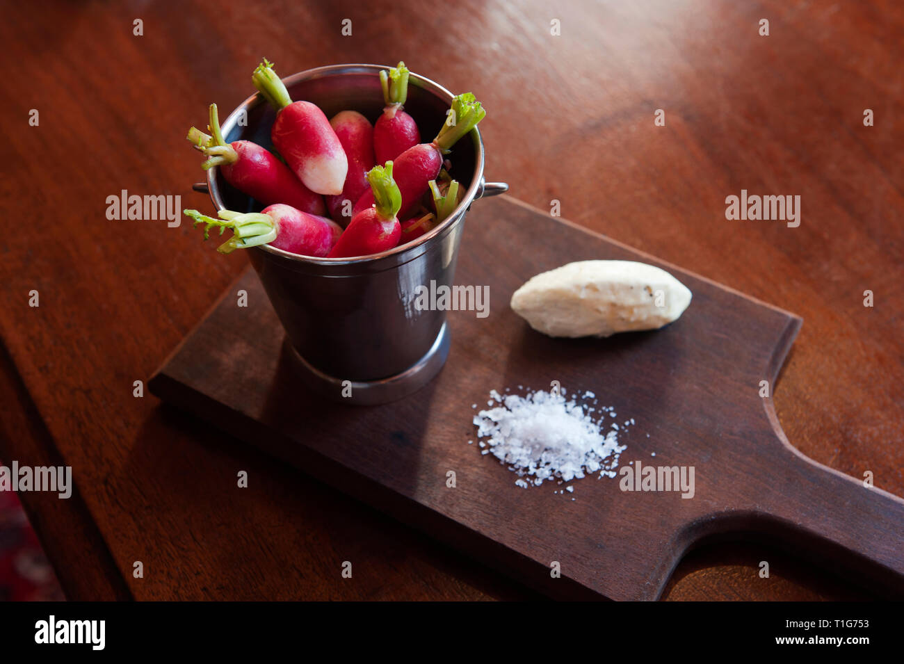 'Bucket of radishes with salt and cheese in cocktail lounge of The Zetter Townhouse in London, England' - Stock Image