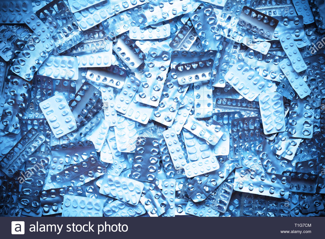 Many empty blister packages on white background, drug overdose, misuse or addiction concept Stock Photo