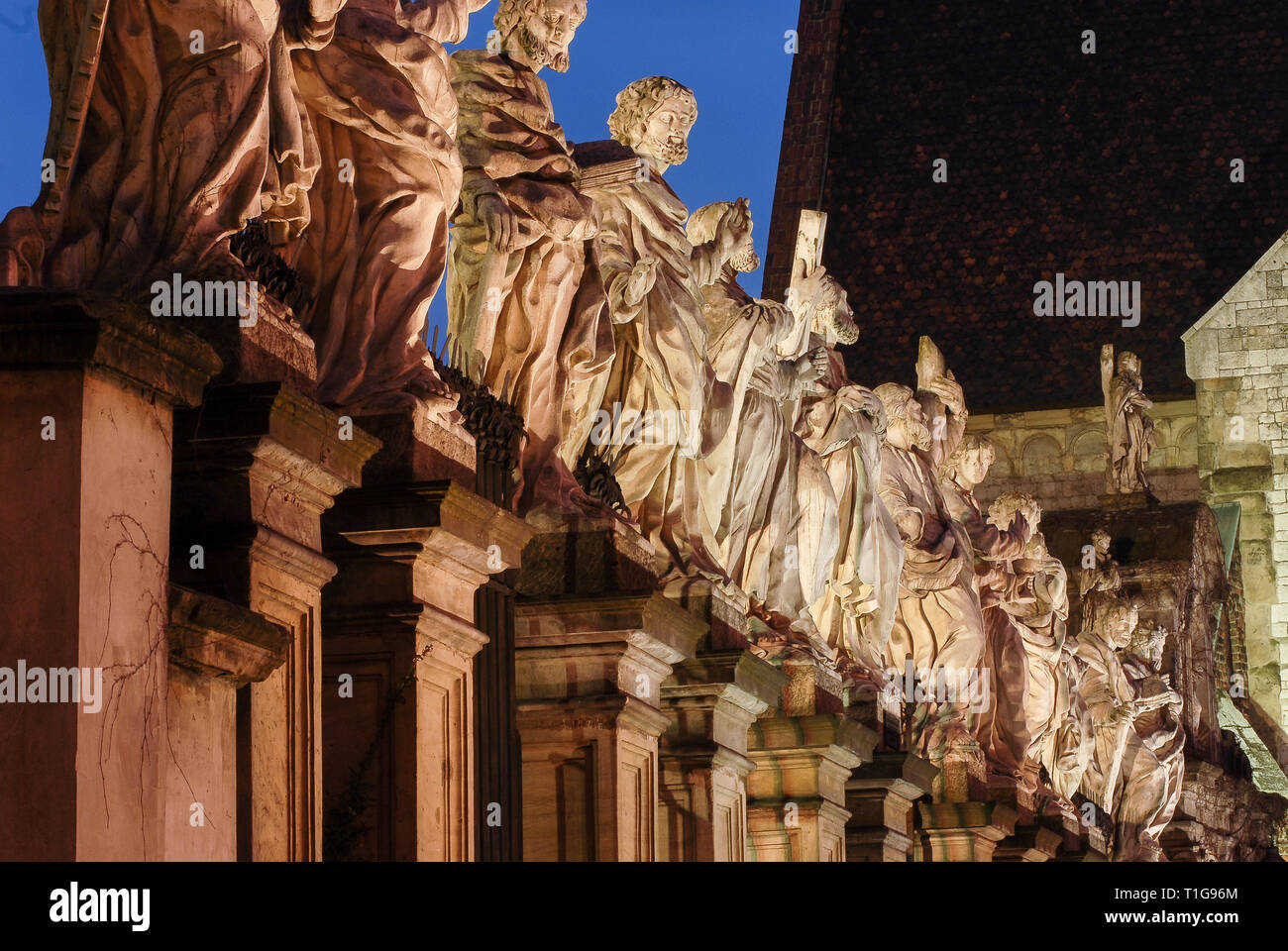Baroque 12 Apostles statues in front of kosciol Sw Piotra i Sw Pawla (Saints Peter and Paul Church) built 1597 to 1619 by Giovanni Maria Bernardoni in - Stock Image