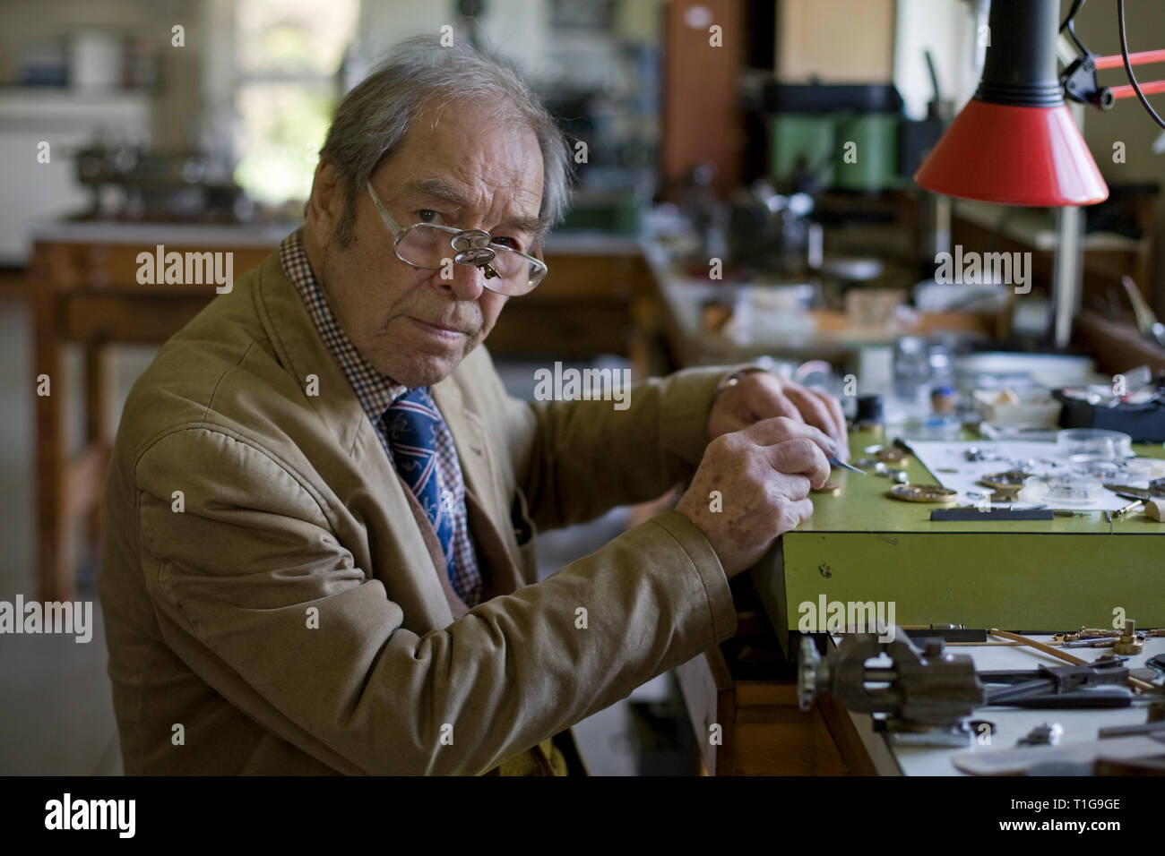 Master horologist George Daniels, pictured in his workshop in the grounds of his home in Ramsey, Isle of Man. Mr Daniels has been making watches for over 60 years and is famous for creating the co-axial escapement. He is one of the few living watchmakers who can create a complete watch by hand; including the case and dial and he is a former Master of the Clockmakers' Company of London. - Stock Image