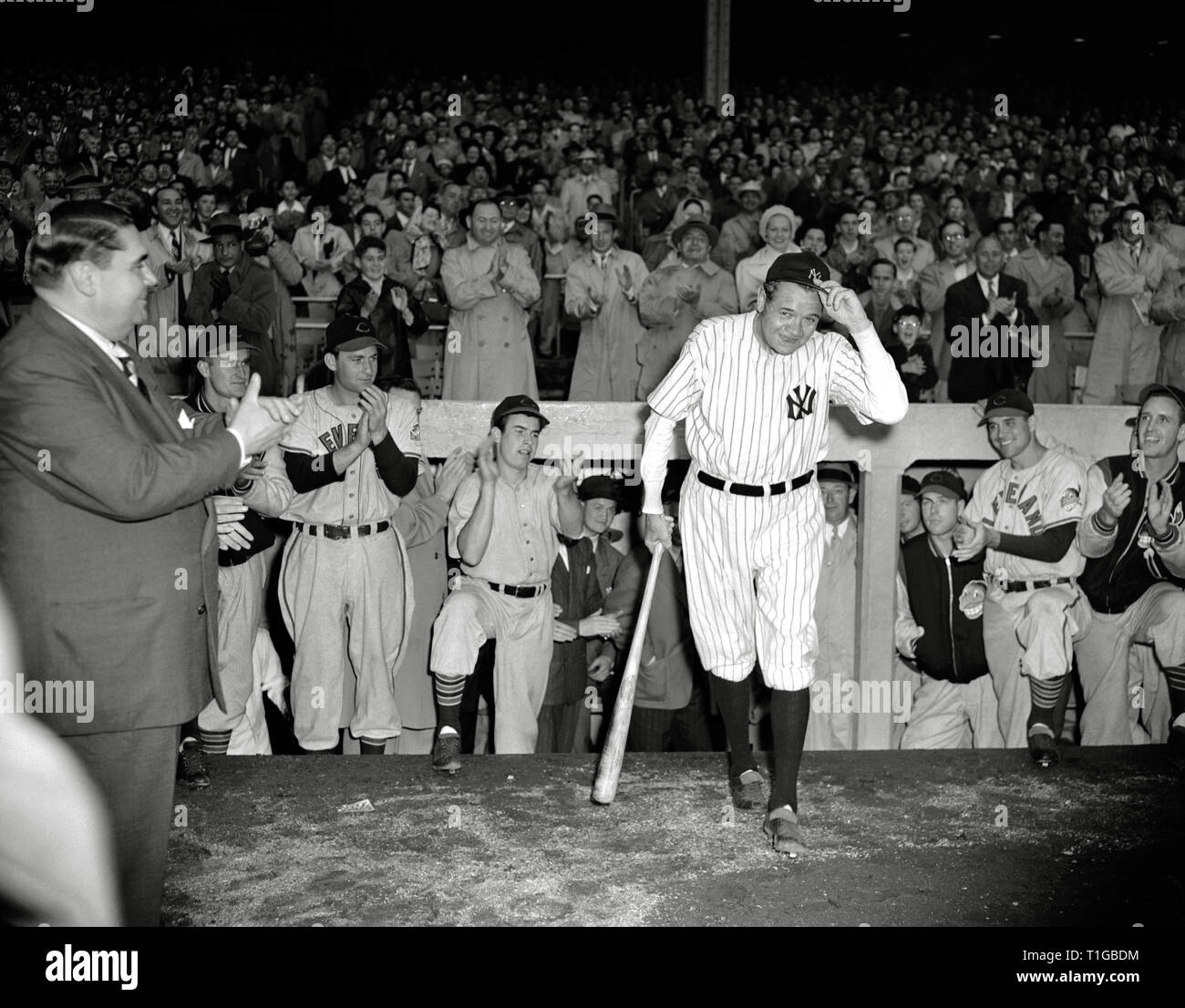 58d16889067 Babe Ruth tips his hat to the cheering crowd during his last appearance at  Yankee Stadium