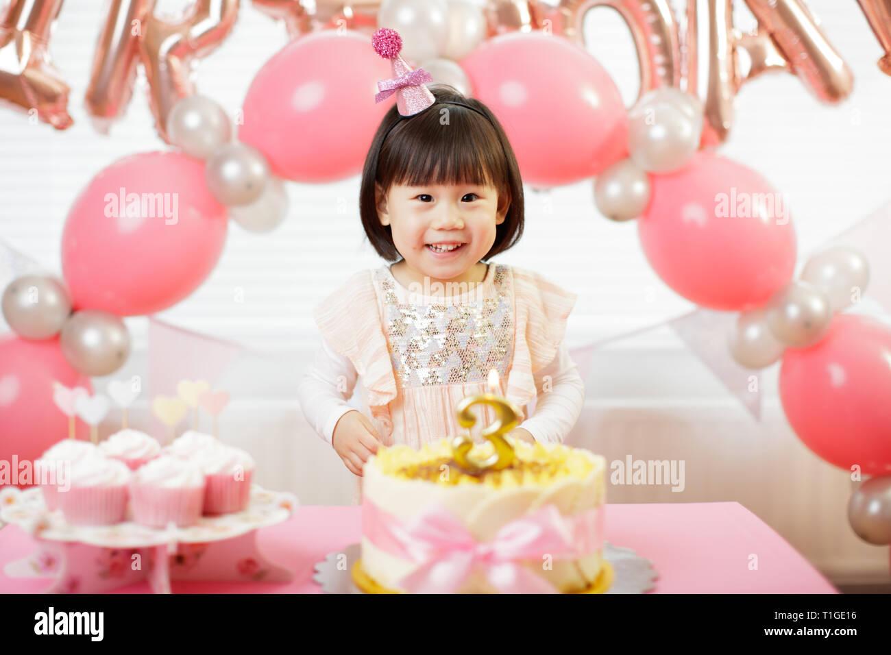 Enjoyable Toddler Girl Celebrating Her Third Birthday At Home Stock Photo Birthday Cards Printable Benkemecafe Filternl