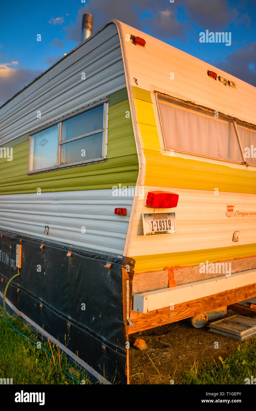 An Old Camper Trailer Seems To Have Seen Better Days And Is Now Off The Grid Living At Sunset In Montana Usa Stock Photo Alamy