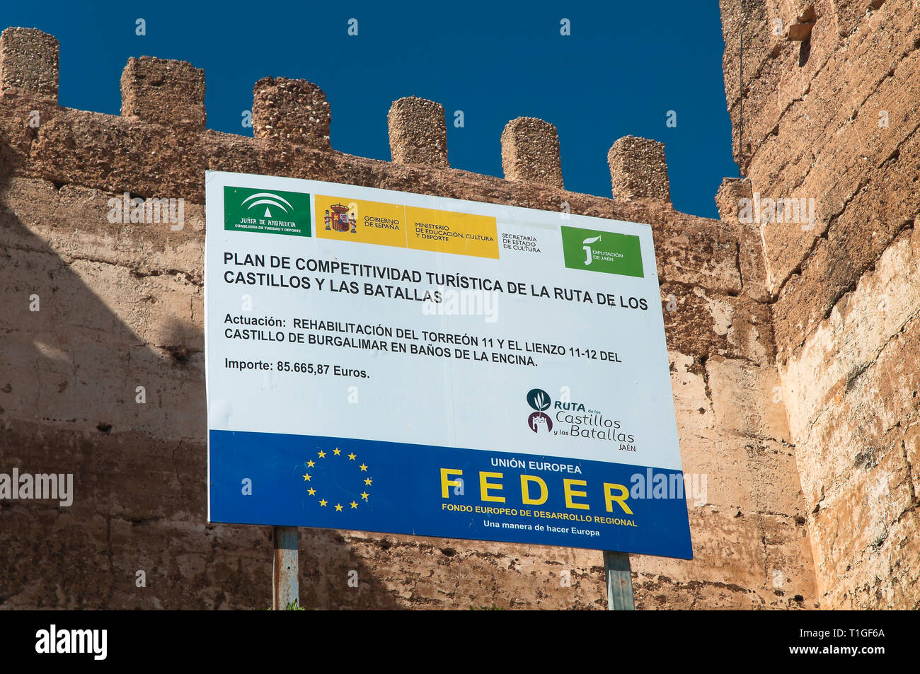 Poster of the European Union. ERDF (European Fund for Regional Development). Castle of Burgalimar (10th century). Baños de la Encina. Jaen province. R - Stock Image