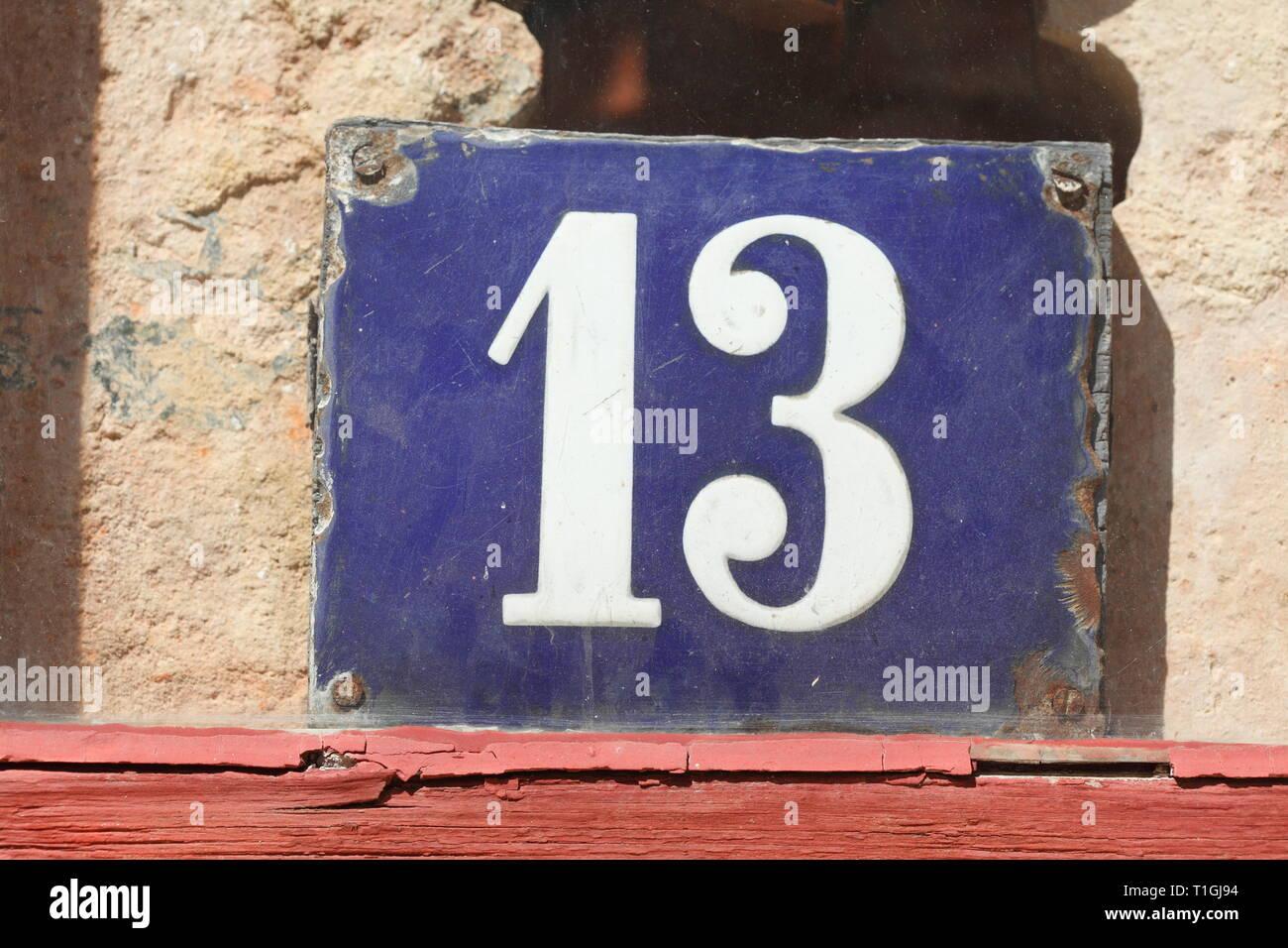 House number plate number thirteen in an old window, old town, Wismar, Mecklenburg-Vorpommern, Germany I Hausnummernschild Nummer Dreizehn  in einem a - Stock Image