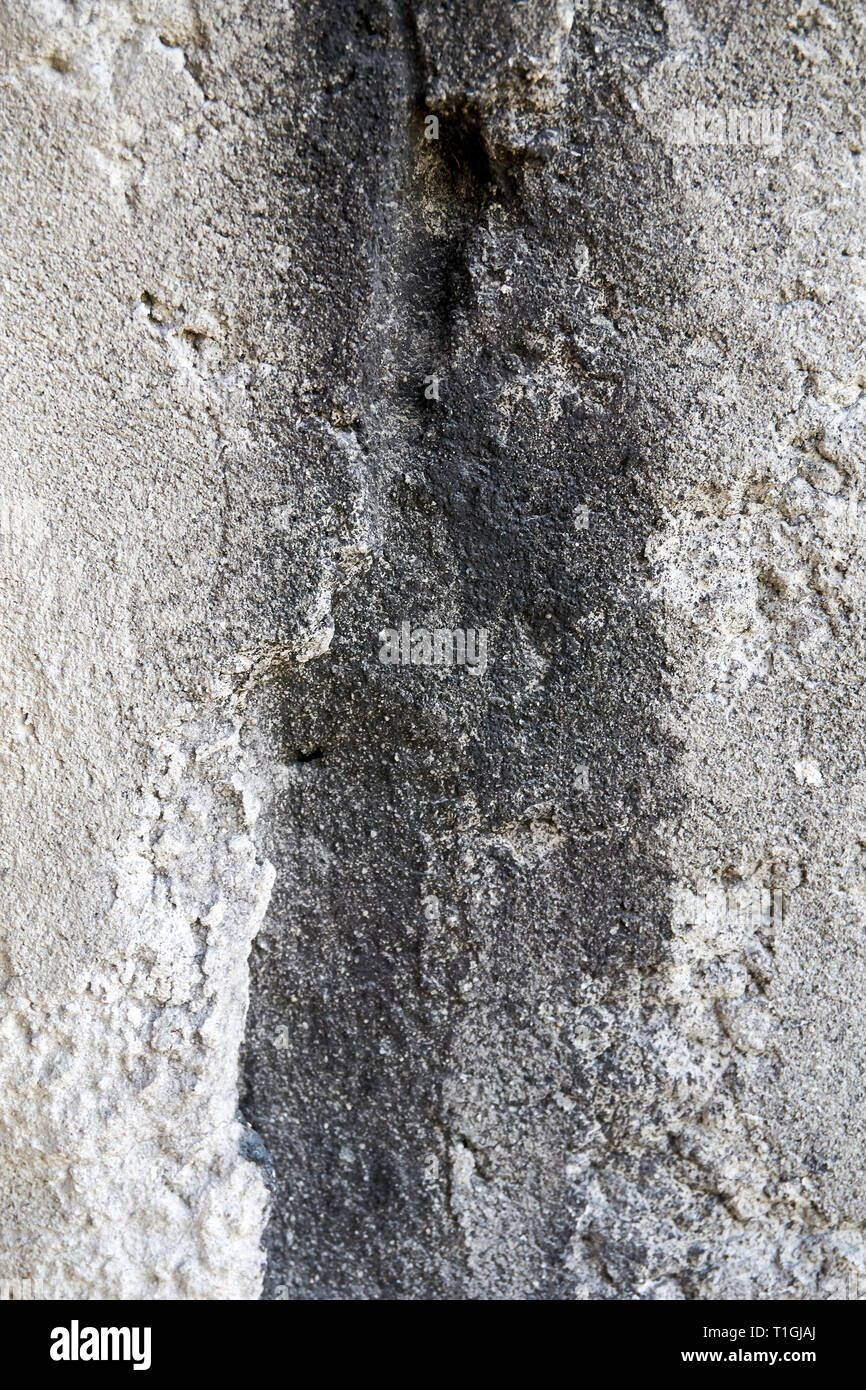 weathered old concrete surface outside - Stock Image