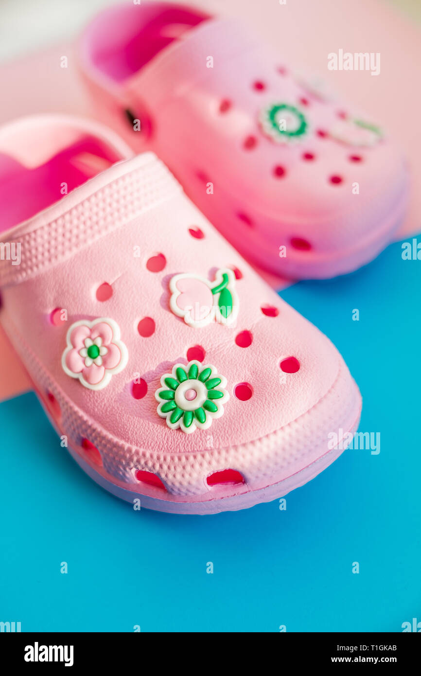 0c708af7d Girl's rubber sandals isolated on the bright background.Kids beach shoes.  Colorful footwear. aqua shoe for tropical beach on summer vacation. Sun